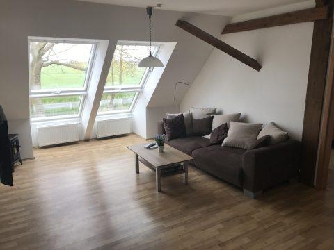 Ferienwohnung an der Nordsee, Wohnzimmer mit Sofa